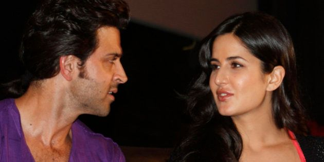 Bollywood actor Hrithik Roshan (L) speaks with Katrina Kaif during a promotional event for their forthcoming