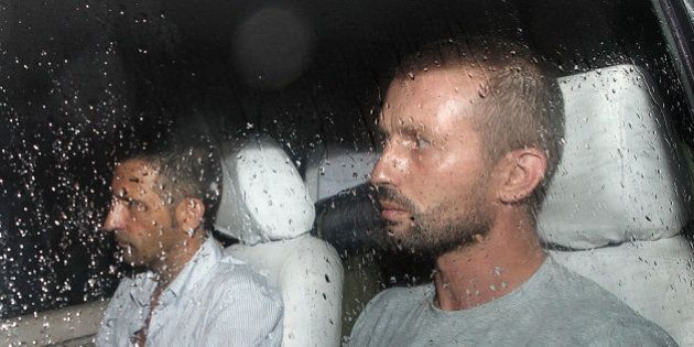 The two Italian marines accused of murdering two Indian fishermen leave after being released following...