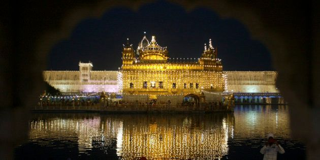 The holy Sikh shrine of Golden Temple is illuminated on the eve of Diwali festival in the northern Indian...