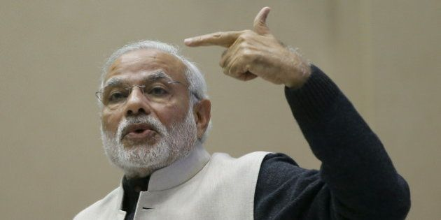 India's Prime Minister Narendra Modi gestures as he addresses a gathering during a conference of start-up...