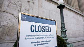 A sign announcing the closure of the National Archives due to a partial government shutdown is displayed in Washington, D.C., U.S., on Thursday, Dec. 27, 2018. The partial U.S. government shutdown will continue at least into this weekend, after House Republicans said they didn't plan to schedule any votes for Friday and President Donald Trump said most federal employees losing pay because of the closure were Democrats. Photographer: Andrew Harrer/Bloomberg via Getty Images