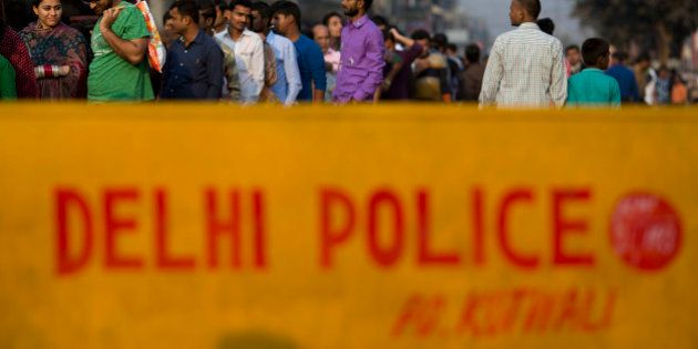 A Delhi police security barricade is placed outside a temple as Hindu devotees queue up to offer prayers...