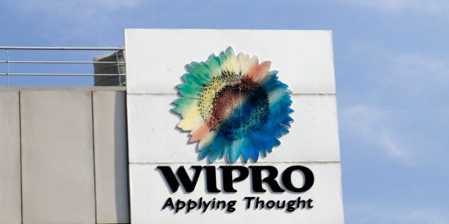 The Wipro Ltd. logo sits atop a building at the company's campus in Bangalore, India, on Tuesday, Jan....