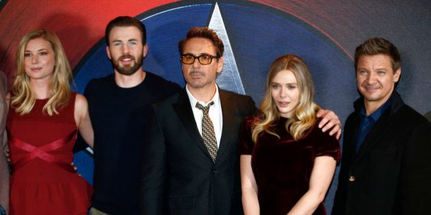 Actors (L-R) Emily VanCamp, Chris Evans, Robert Downey Jr, Elizabeth Olsen and Jeremy Renner, pose for...