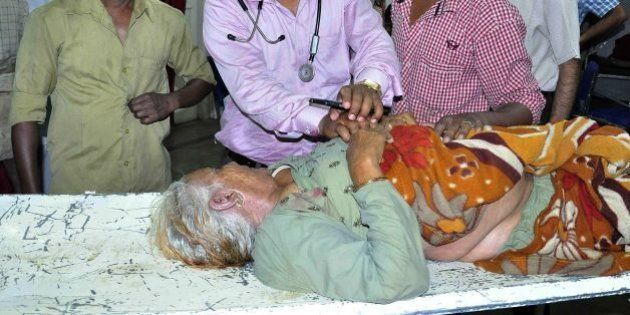 An Indian pilgrim injured after a tent collapse caused a stampede at a religious event is treated by...