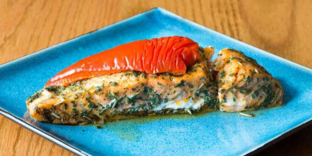 TORONTO, ONTARIO, CANADA - 2016/04/22: Canadian cuisine: salmon stuffed with cheese, marinated with herbs...