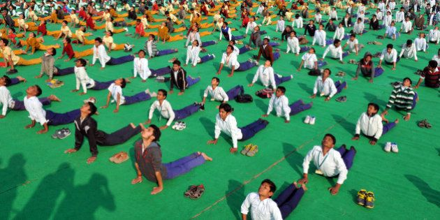 INDORE, INDIA - JANUARY 12: School students participate in Surya Namaskar function organized at Chiman...