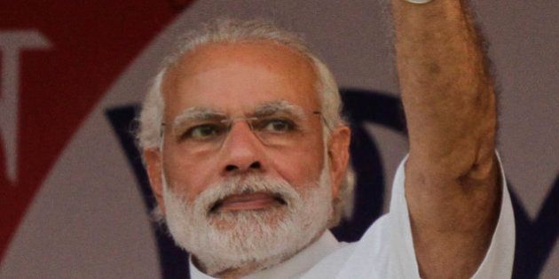 Indian Prime Minister Narendra Modi, waves as he arrives at an election rally of the ruling Bharatiya...