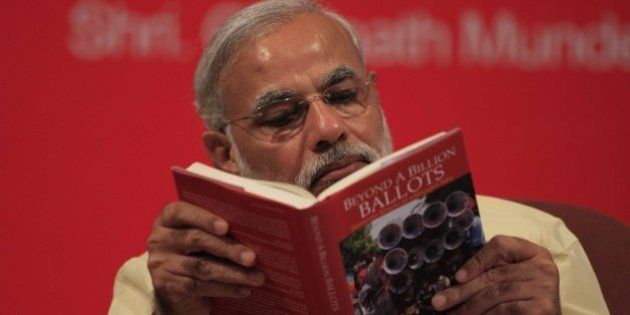 MUMBAI, INDIA - JUNE 27: Gujarat Chief Minister Narendra Modi reading the book Beyond A Billion Ballots...