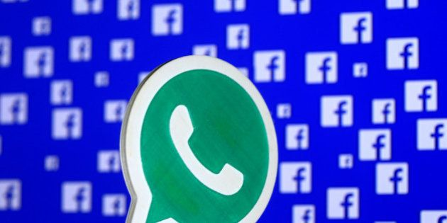 A 3D printed Whatsapp logo is seen in front of a displayed stock graph in this illustration taken April...