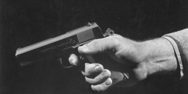 Man holding gun, close up of