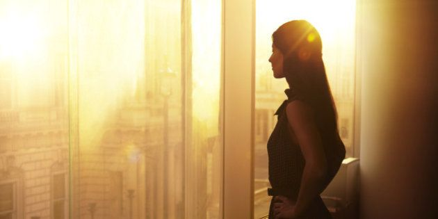 Business woman looking over the city at