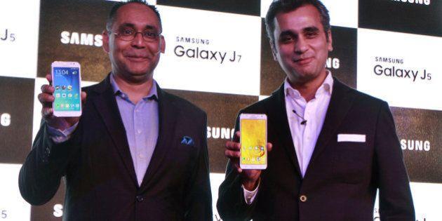 NEW DELHI, INDIA - JULY 16: Manu Sharma (L), Director, Mobile at Samsung India and Asim Warsi, Vice President...