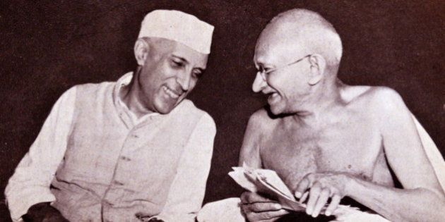 Pandit Jawaharlal Nehru, later Prime Minister of India, (left) with Mohandas Karamchand Gandhi (1869...