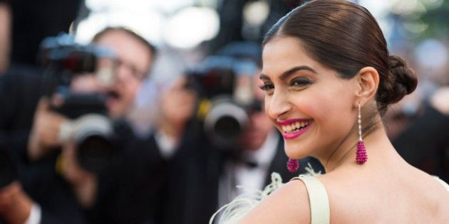 Actress Sonam Kapoor poses for photographers upon arrival for the screening of the film Inside Out at...
