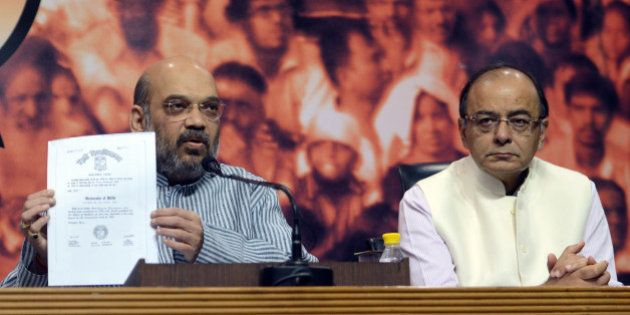 NEW DELHI, INDIA MAY 09: Finance Minister Arun Jaitley and BJP President Amit Shah during a press conference...