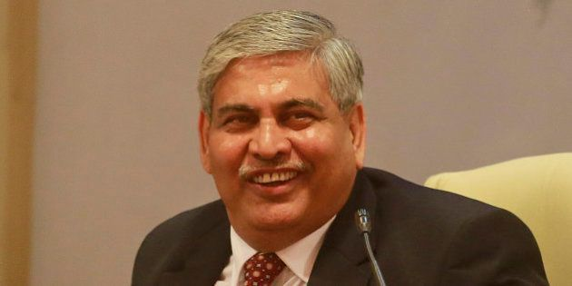 Board of Control for Cricket in India (BCCI)'s newly elected president Shashank Manohar smiles during...