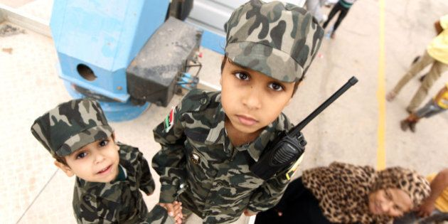 Libyan children dressed in military fatigues attend a demonstration in the eastern coastal city of Benghazi...