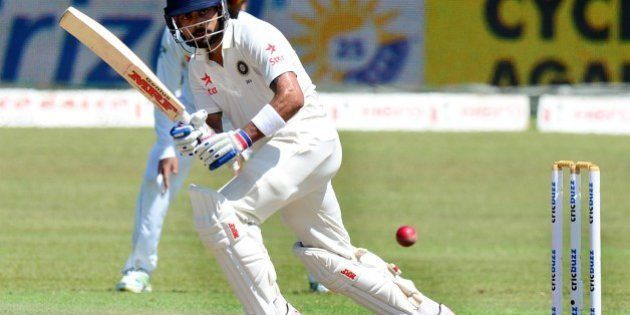 Indian cricket captain Virat Kohli plays a shot during the fourth day of the third and final Test match...