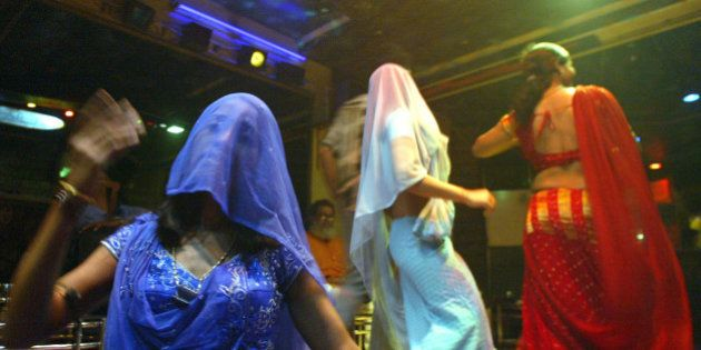 Indian bar girls perform at a dance bar in Bombay May 5, 2005. The government of the western Indian state...