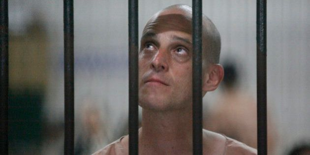 Australian writer Harry Nicolaides waits inside a detention cell of the Bangkok's Criminal Court January...