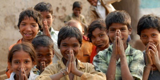India: Children in a village near Nagpur, Maharashtra, doing 'Namaste' which is a form of welcome or...