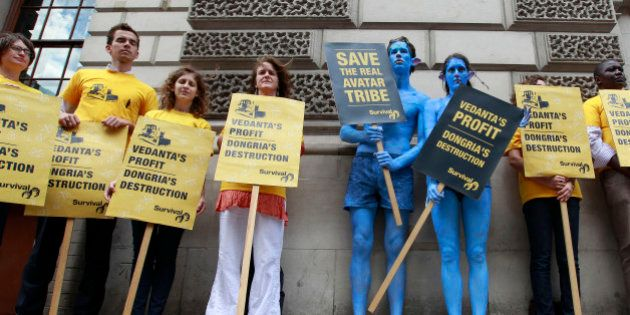 Demonstrators, including a pair dressed as characters from the film Avatar, protest against British mining...