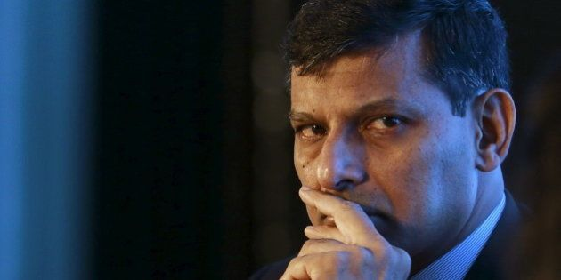Reserve Bank of India (RBI) Governor Raghuram Rajan listens to a question during an industry event in...