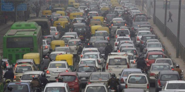 Vehicles sit in traffic on a road shrouded in haze in New Delhi, India, on Monday, Jan. 20, 2014. India,...