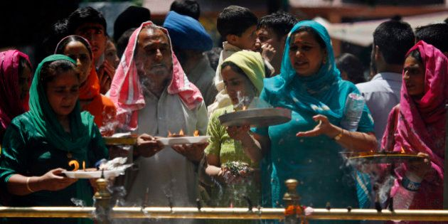 Kashmiri Hindus, or Pandits, pray during an annual festival at a shrine in Khirbhawani, 30 km (19 miles)...