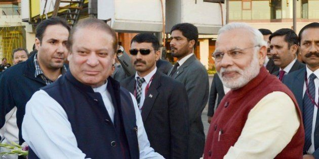 LAHORE, PAKISTAN - DECEMBER 25: Prime Minister of Pakistan Nawaz Sharif (L) shakes hands with Indian...