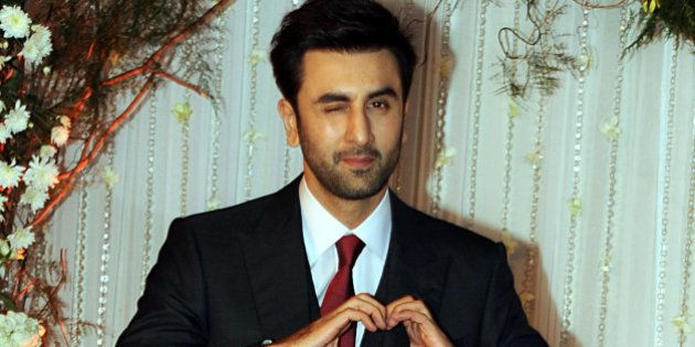 Indian Bollywood actor Ranbir Kapoor poses as he attends a reception after the wedding of fellow thespians...