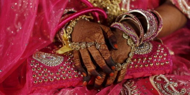 A Muslim bride waits for the start of a mass marriage ceremony in Mumbai, India, January 27, 2016. A...