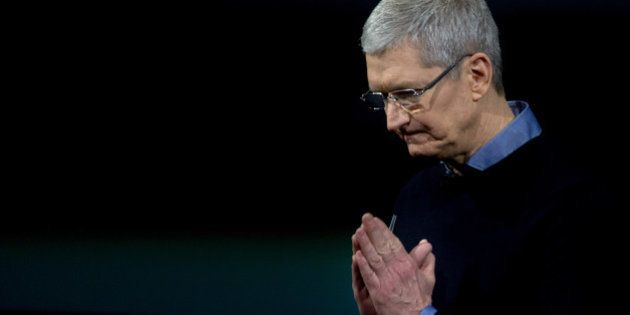 Apple CEO Tim Cook gestures during a media event at Apple headquarters in Cupertino, California on March...