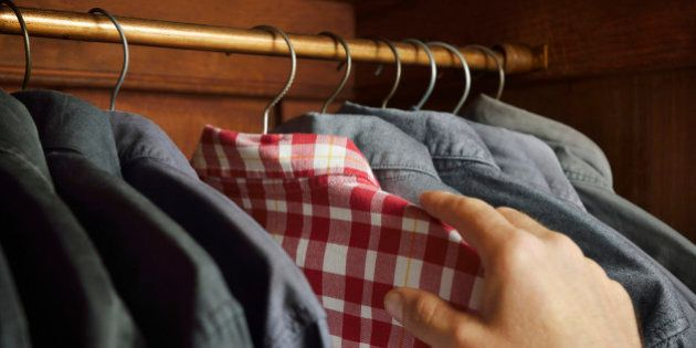 Checked shirt being selected over grey