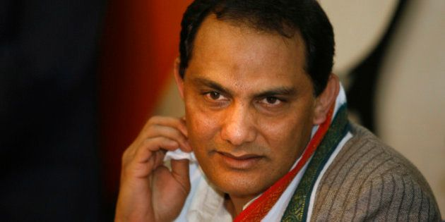 Former Indian cricket captain Mohammed Azharuddin speaks to the media after announcing his decision to...