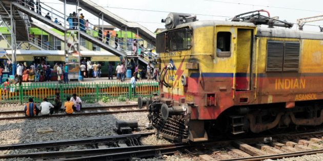 KOLKATA, INDIA SEPTEMBER 29: Train arriving at Dundum rail station on September 29, 2015 in Kolkata,...