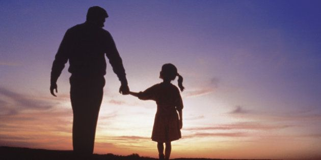Silhouette of father and daughter