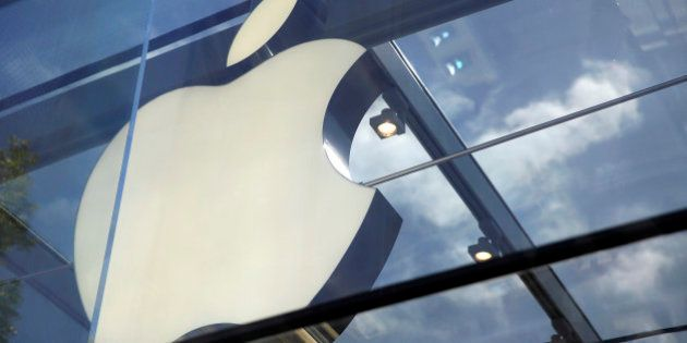 The Apple logo is seen atop the Apple Store Thursday, March 31, 2016, in Palo Alto, Calif. (AP Photo/Eric