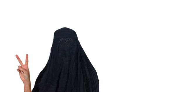 Woman in a burka making a peace