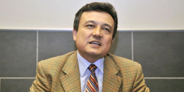 Dolkun Isa, Secretary General of the World Uyghur Congress speaks to an AFP reporter during an interview...