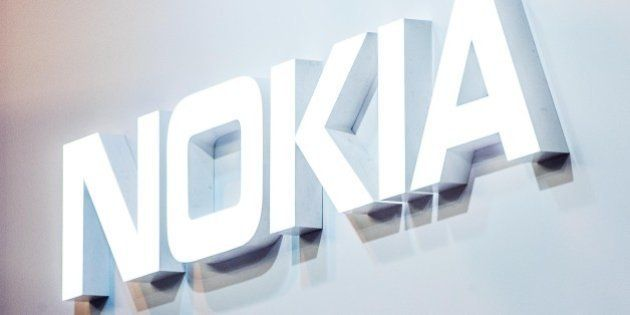 BARCELONA, SPAIN - FEBRUARY 22: A logo sits illuminated outside the Nokia pavilion on the opening day...