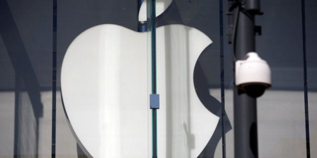 The logo of Dow Jones Industrial Average stock market index listed company Apple (AAPL) is seen next...