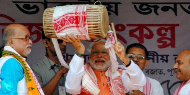 Hindu nationalist Narendra Modi (C), the prime ministerial candidate for India's main opposition Bharatiya...