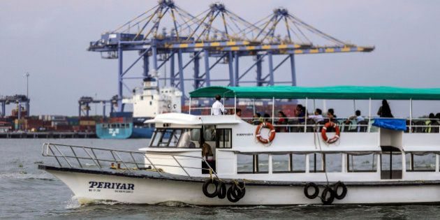 A ferry travels past the Kochi International Container Transhipment Terminal (ICTT), operated by DP World...