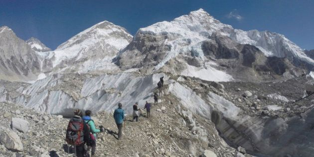 In this Monday, Feb. 22, 2016 photo, international trekkers pass through a glacier at the Mount Everest...
