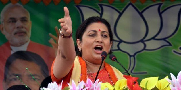 Indian Minister for Human Resource Development Smriti Irani addresses party workers during a Bharatiya...