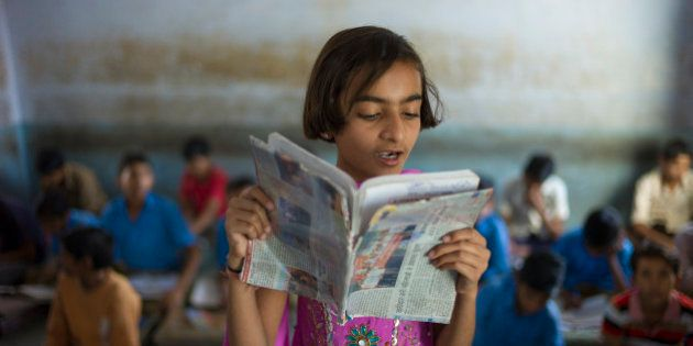 INDIA - MARCH 17: Indian girl reading aloud during English lesson at Rajyakaiya School in Narlai village, Rajasthan, Northern India (Photo by Tim Graham/Getty Images)