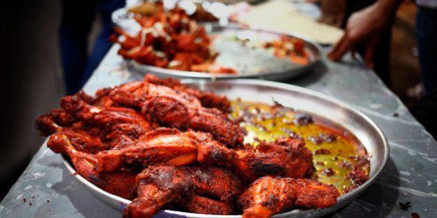 Display of chicken tandoor at food stalls outside Jamiatul Qureshi Masjid Camp, Pune(India). During ramadan...