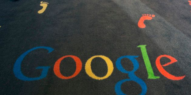 FILE - This Tuesday, Dec. 10, 2013 file photo shows the Google logo printed on a carpet during the inauguration...
